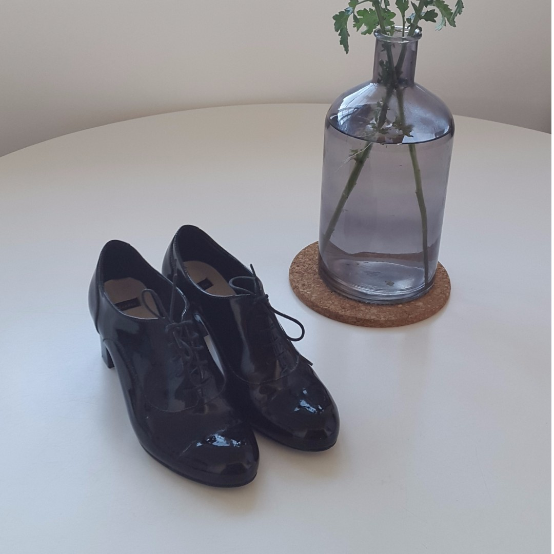 Black leather Oxford style shoes