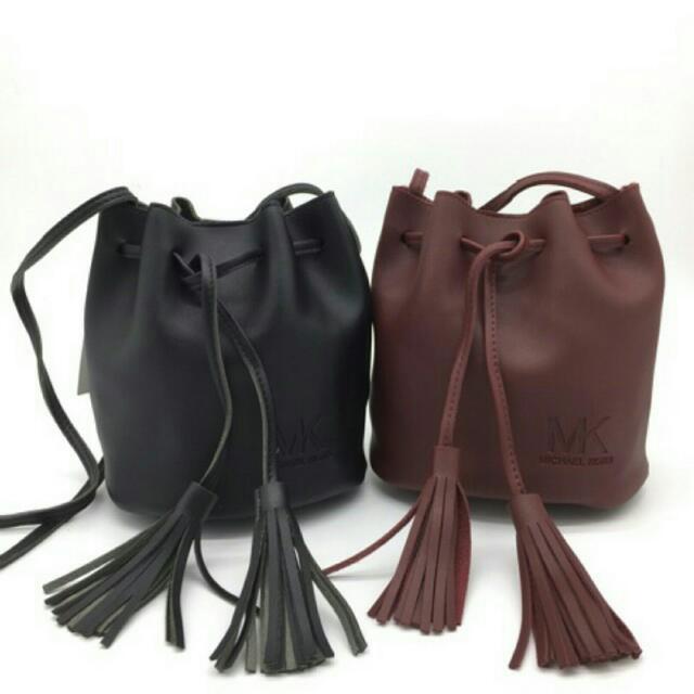 MK Tassel Sling Bag