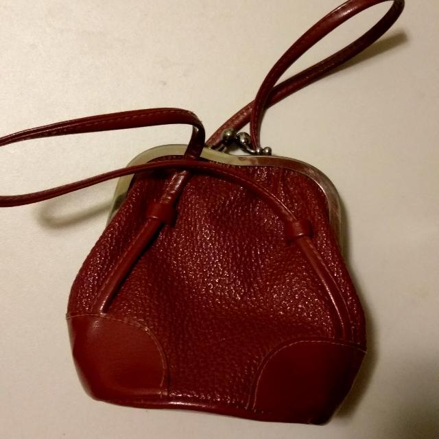 小紅棕手拿口金包👛