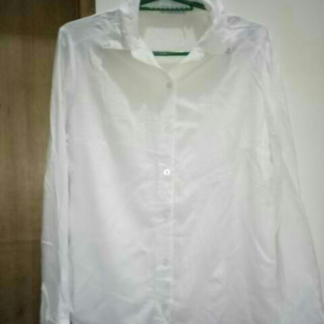 folded and hung white long sleeve