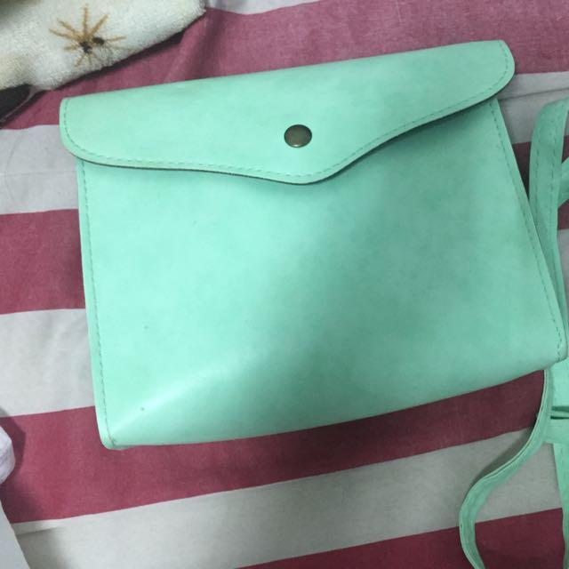 贈 藍綠色小包