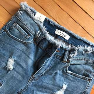 Distressed Back And Front Medium Blue Jeans