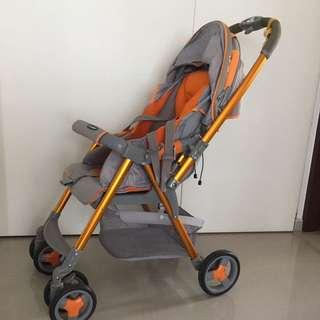Orange Combi Stroller Reversible