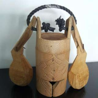 Wooden cow bells with carvings