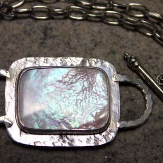 Mother of Pearl set in Sterling Silver with stainless steel chain bracelet.