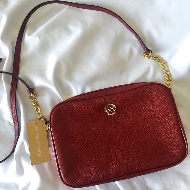 NEW MK SLING BAG IN MAROON