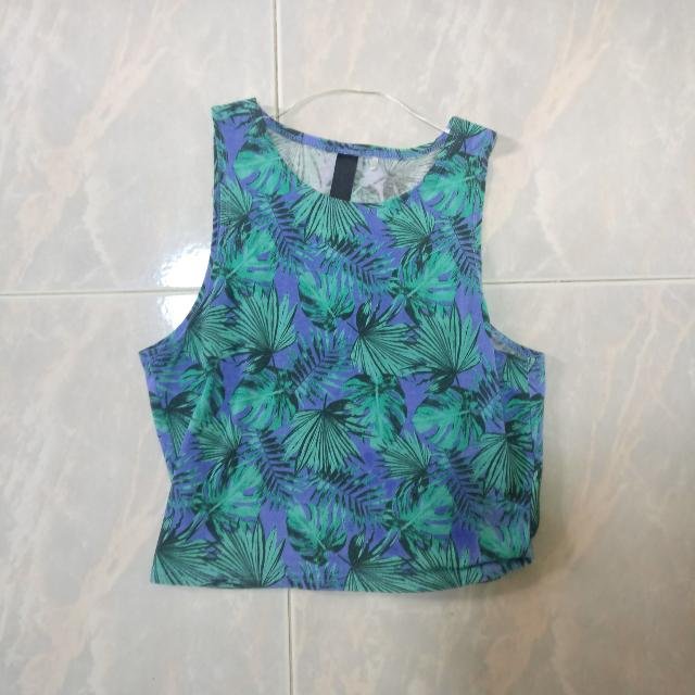 Turquoise crop top with tropical plants