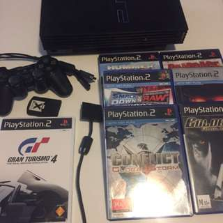 PS2 Console, 1x Sony Controller, 16MB Memory Card & 7x Games