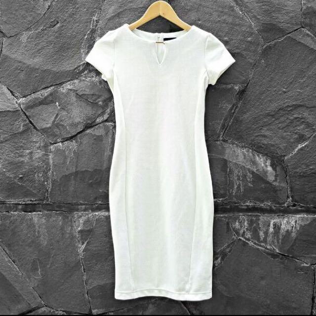 the executive white bodycon dress