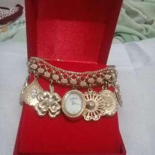 Anne Klein Swarovski Crystal accented gold Charm Bracelet watch