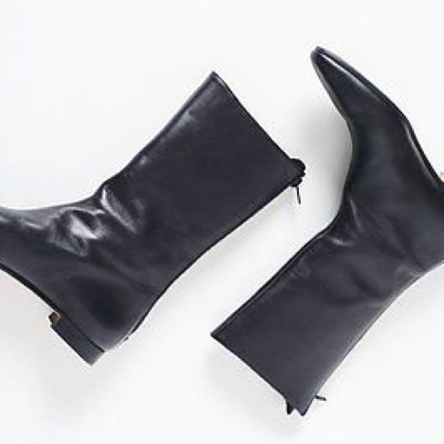 Manolo Blahnik black leather mid length boot. Size 36