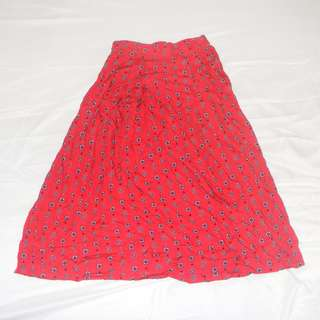 Red patterned skirt.