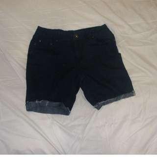 Dark blue jean shorts.