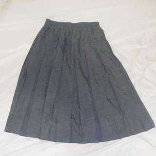 Dark grey, knee length skirt.