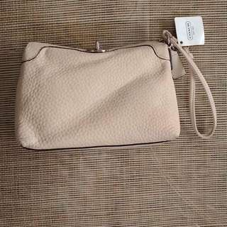 Coach leather wristlet (new, unused, from the US)