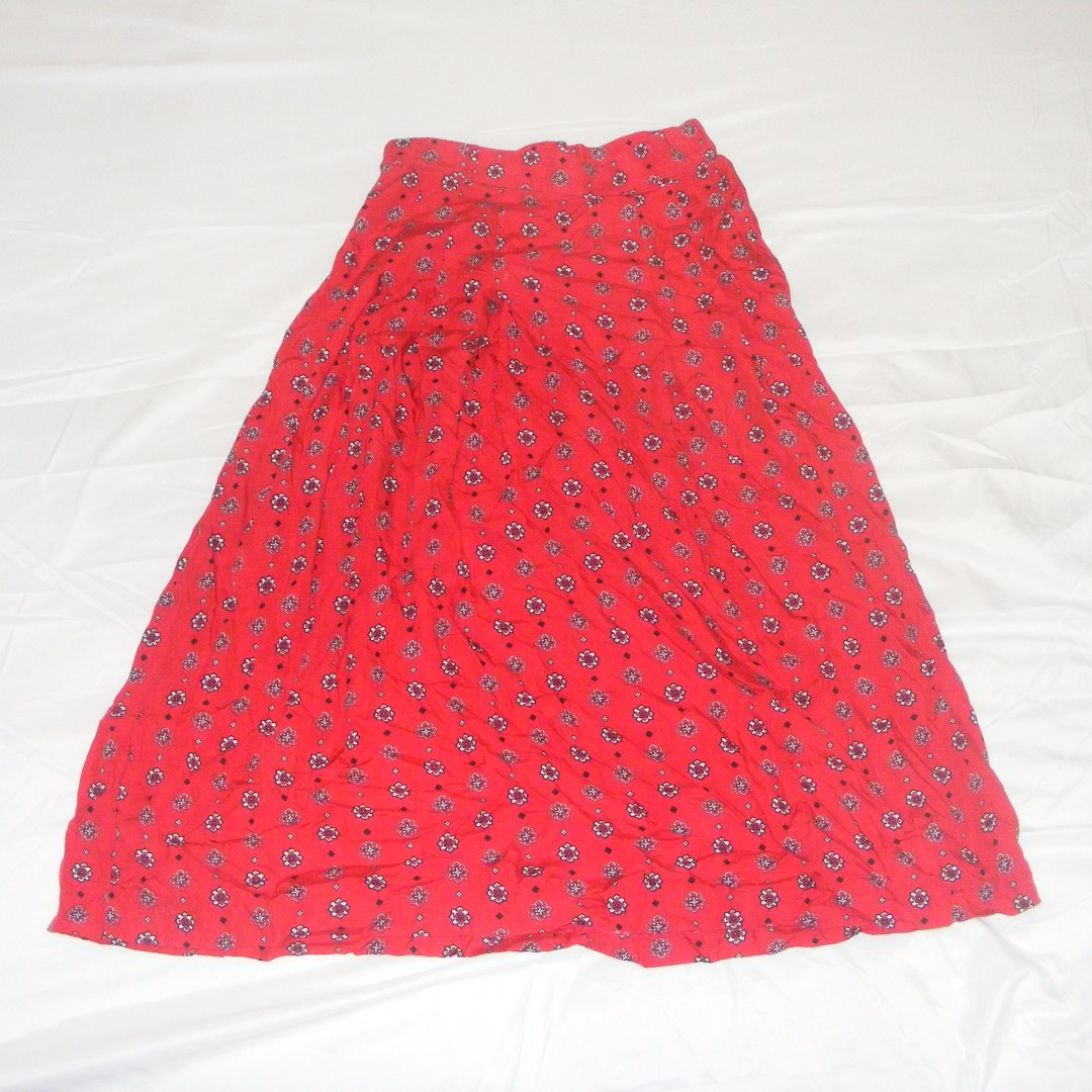 Red patterned skirt.