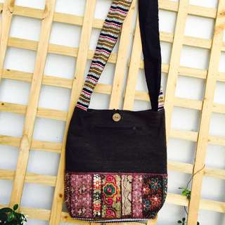 Brown ethnic mirror work embroidery jhola bag.