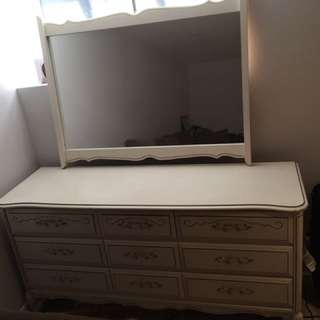Off-white antique dresser with mirror.