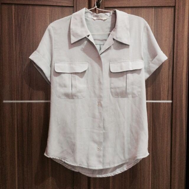 greyish shirt