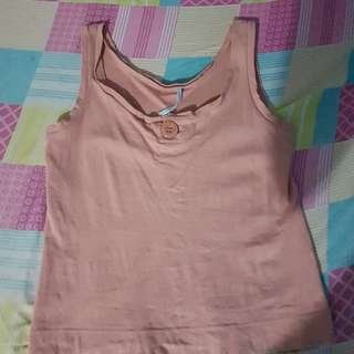 Sleeveless With Button Design In Front
