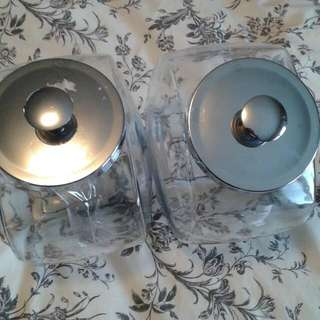 2 Brand New Glass Cookie Jars. Crome lids