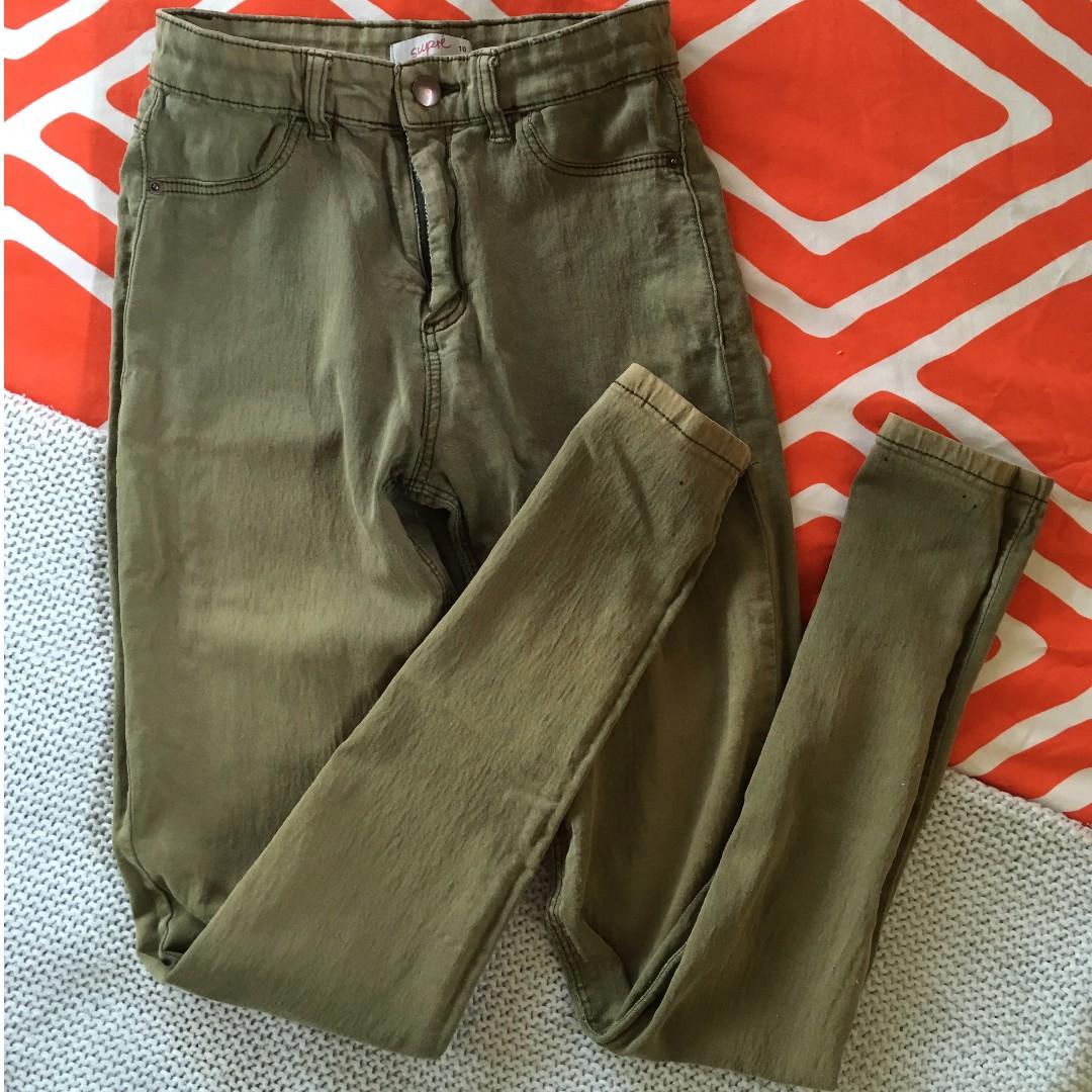 Distressed khaki skinny jeans