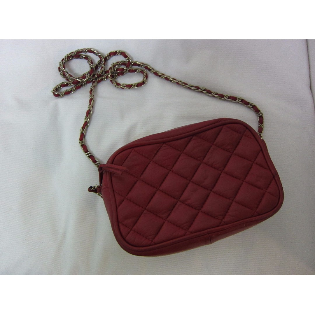 Red cross body full leather purse with metal chain