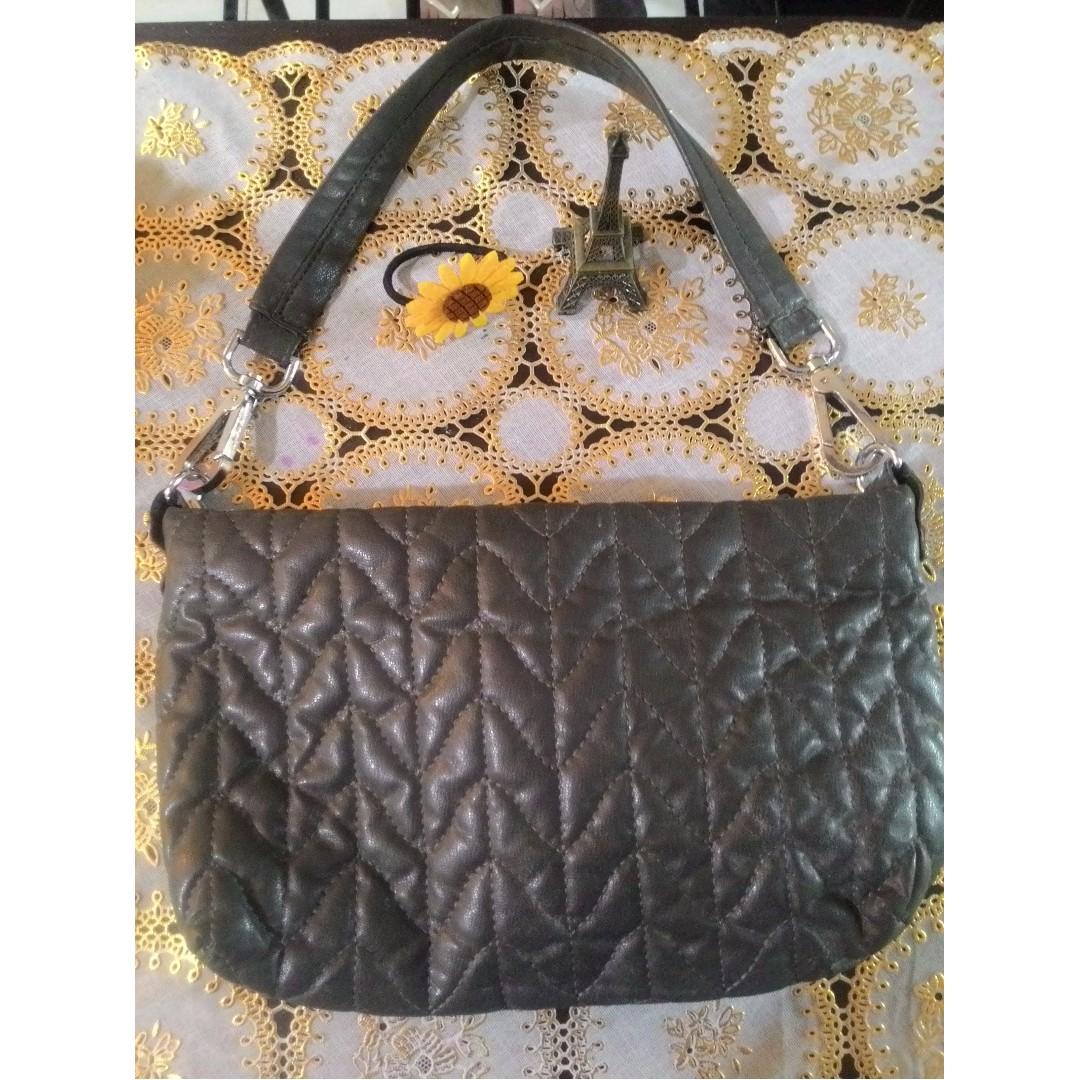 Gray stitch patterned leather (man made) shoulder bag.