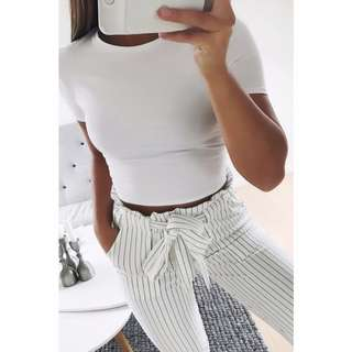 15% off WHITE ROSAL HIGH WASTED STRIPED TROUSERS
