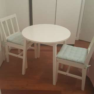 Three Piece Table And Chairs