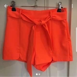 Bright orange high waisted shorts