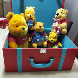 5 Winnie The Poohs With A Red Box.