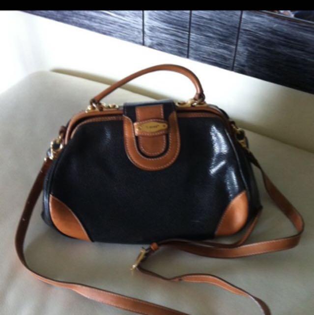 0297a57c165e i Santi Leather Bag