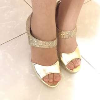 Gold high heels by Gioretti
