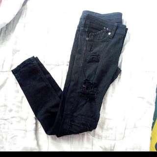 Tattered Black Pants
