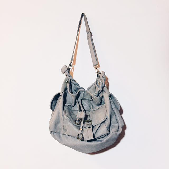 grey sling/carry handbag