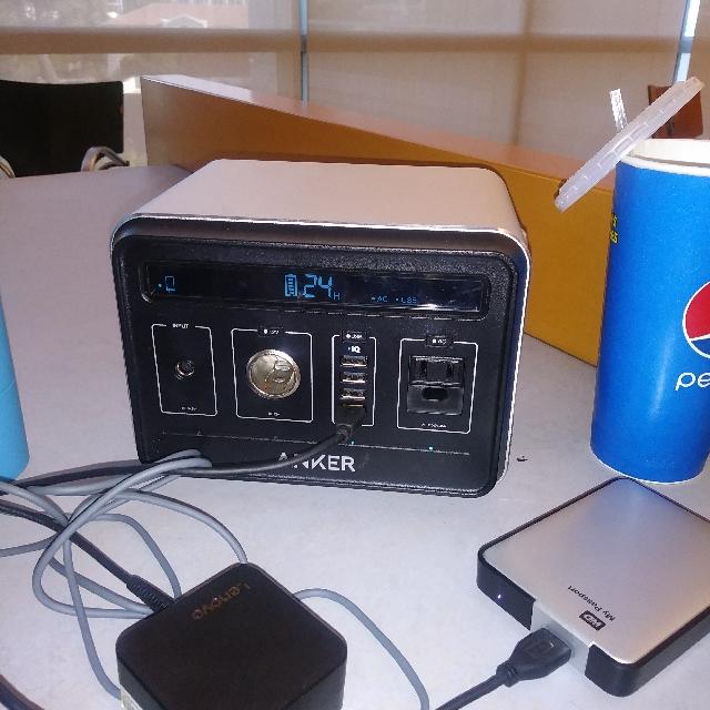 Power Hoise Speaker And Laptop