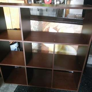 Brown Cabinet With Color Shelves