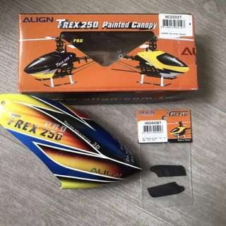 Original Trex 250 canopy(fiber glass)tail blade(carbon fiber) Never  use before...condition 10/10 delivery can be arrange