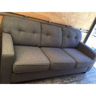 gray suede 3-seater sofa