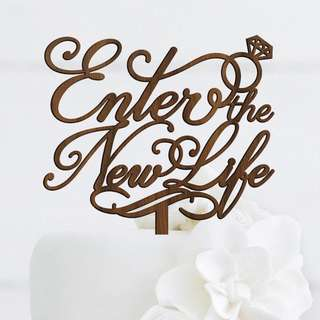 Enter the New Life walnut wood cake topper