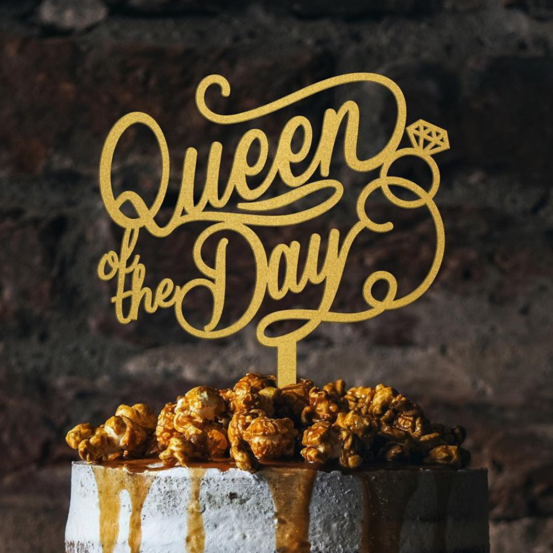 Queen of the Day gold acrylic cake topper
