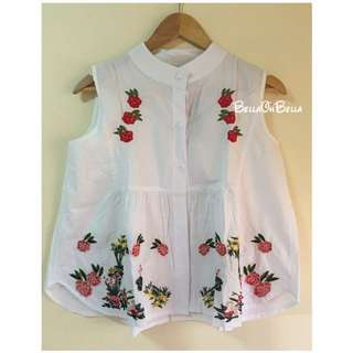 White top with patches