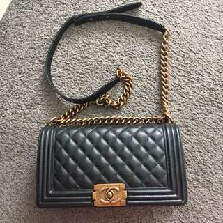 Chanel caviar leather black boy bag aged gold hardware