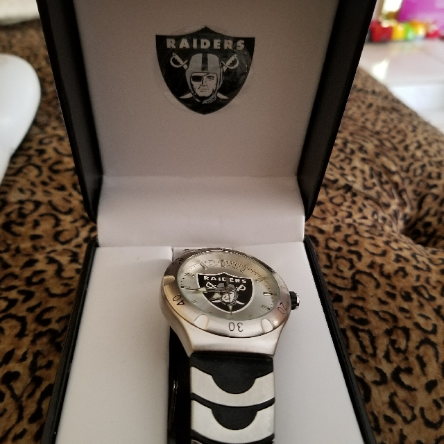 RAIDERS WATCH WRIST BAND IS METAL WITH RUBER NEVER USE $100.00