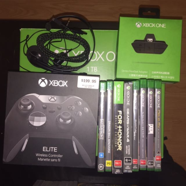 Xbox one 1tb elites controller +normal controller plus 9 games
