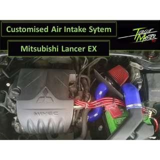 Mitsubishi Lancer EX . Air intake System with cold air pipe and Heat shield. Air Filter . Open Pod . Carbon Charger . Close Pod.