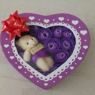 Bear and purple flowers in a heart shaped box