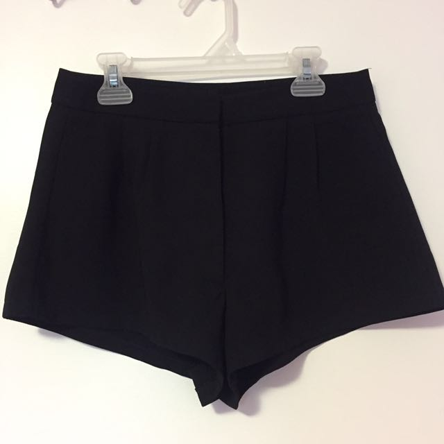 High waisted black pleated shorts