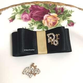 Satin Dior bow brooch